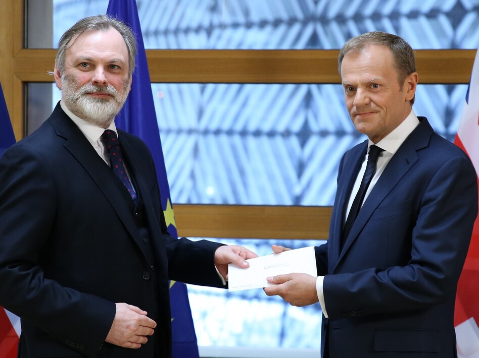 British Ambassador to the EU Tim Barrow (left) delivers Prime Minister Theresa May's formal notice of the U.K.'s intention to leave the bloc to European Council President Donald Tusk in Brussels on Wednesday. (Anadolu Agency/Getty Images)