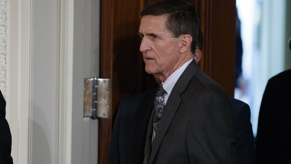 Former national security adviser Michael Flynn's lawyer says Flynn has offered to testify about Trump campaign contacts with Russia if he gets immunity from prosecution. Flynn is seen at the White House on Feb. 13. (Evan Vucci/AP)