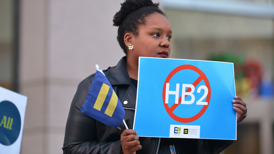 Cassandra Thomas of Human Rights Campaign holds a sign advocating the repeal of HB2 on Dec. 7, 2016, in Charlotte. (Brian Gomsak/AP Images for Human Rights Campaign)