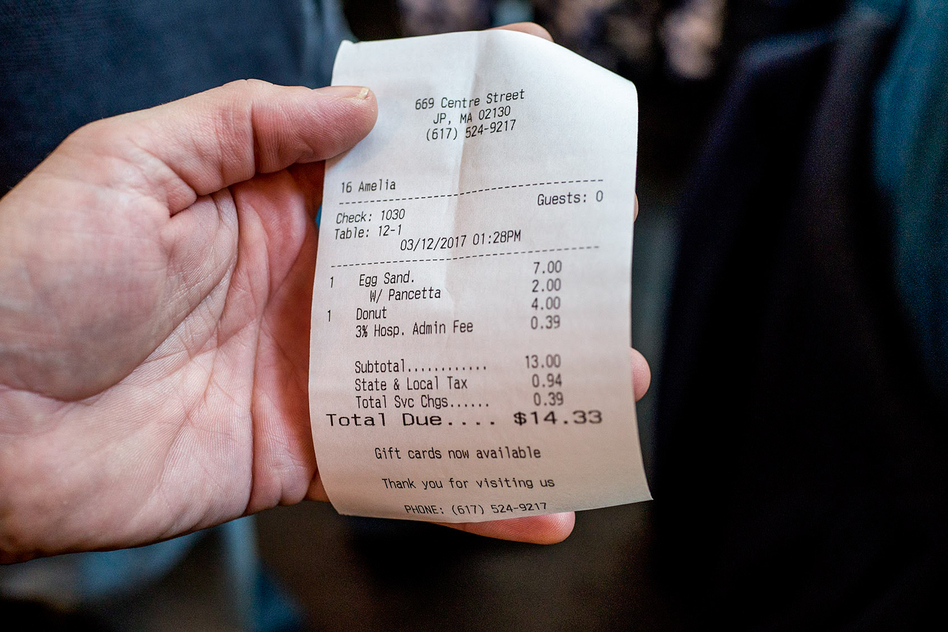"A receipt from Centre Street Cafe in Jamaica Plain, Mass., includes a 3 percent ""hospitality administration fee,"" which comes out to 39 cents on $13 of food sales. The entire fee goes to nontipped employees in the kitchen. (Simón Rios/WBUR)"