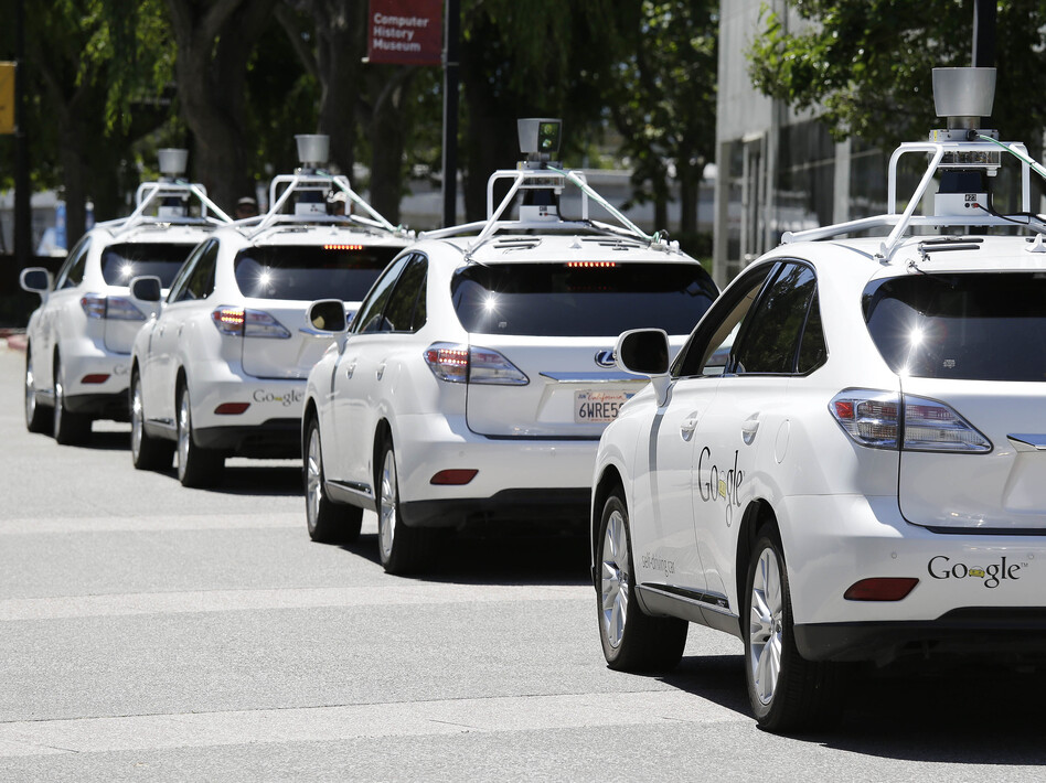 Google self-driving cars are shown outside the Computer History Museum in Mountain View, Calif., in May 2014. (Eric Risberg/AP)