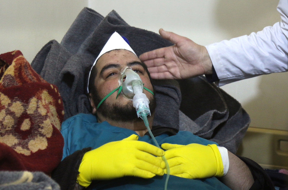 A Syrian man receives treatment following a suspected toxic chemical attack Tuesday in Khan Shaykhun, a rebel-held town in Syria's northwestern Idlib province. At least 72 people were killed, including a number of children. (Mohamed al-Bakour/AFP/Getty Images)