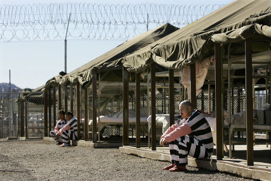 Inmates sit next to their bunks in the courtyard of the Tent City Jail in Arizona's Maricopa County. (Charlie Riedel/AP)