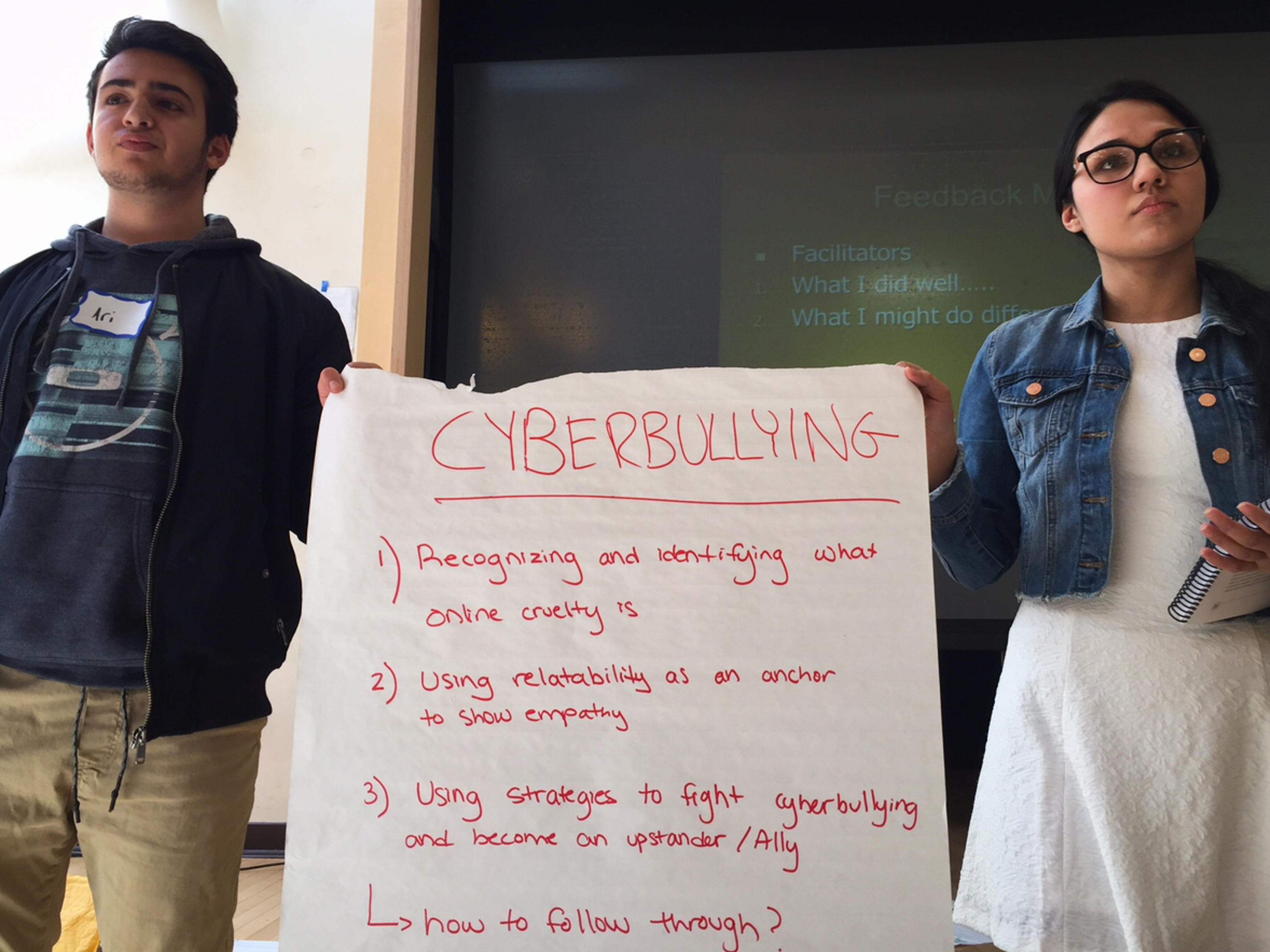 Brookline High School students Ari Lazowski (left) and Iman Khan practice presenting an exercise on cyberbullying.     (Tovia Smith/NPR)