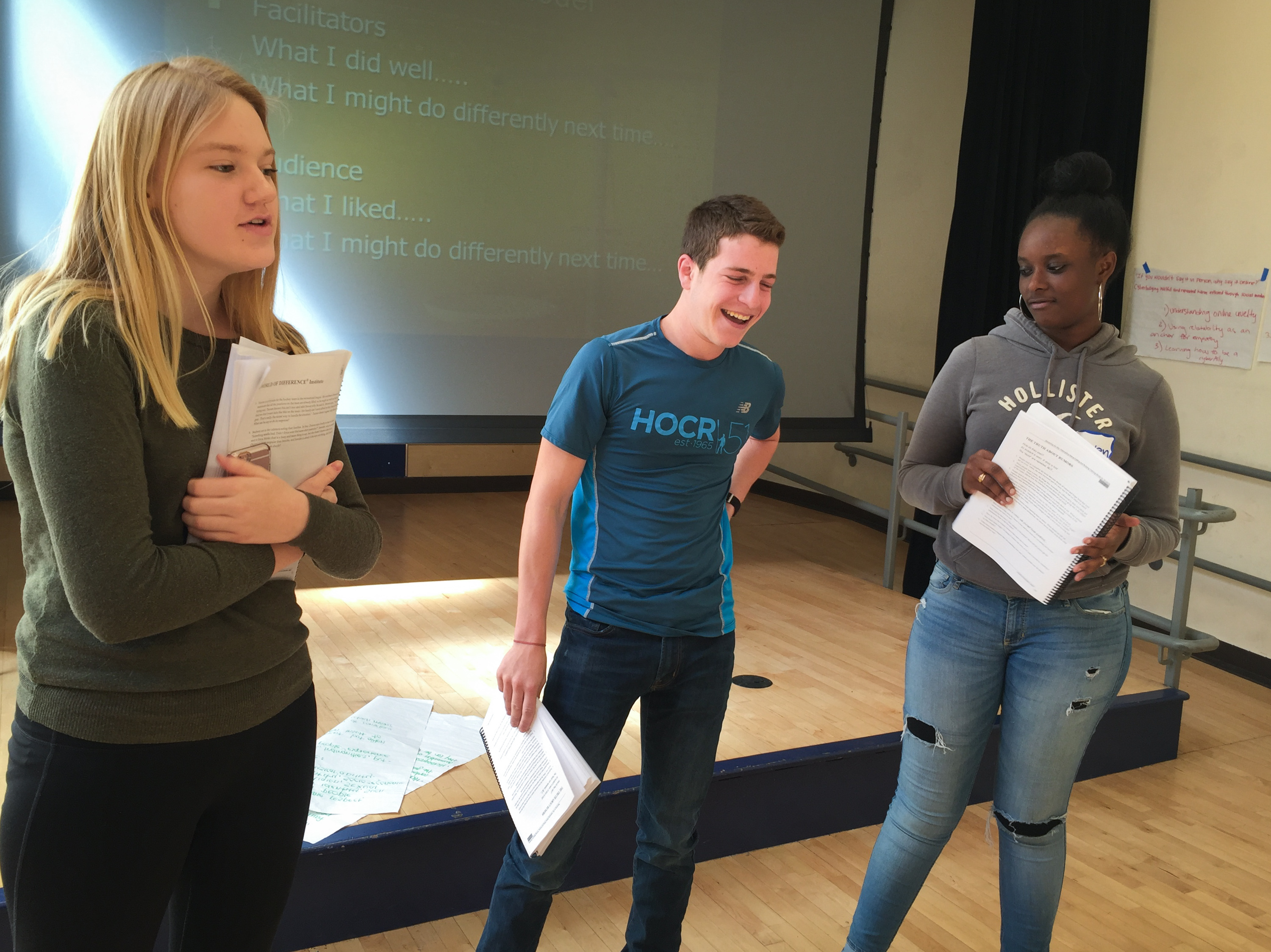 After participating in tolerance workshops for two days, Maddie Kennedy (left), Josh Gladstone and Raven Bogues practice being presenters before they run the same workshops for their peers.     (Tovia Smith /NPR)