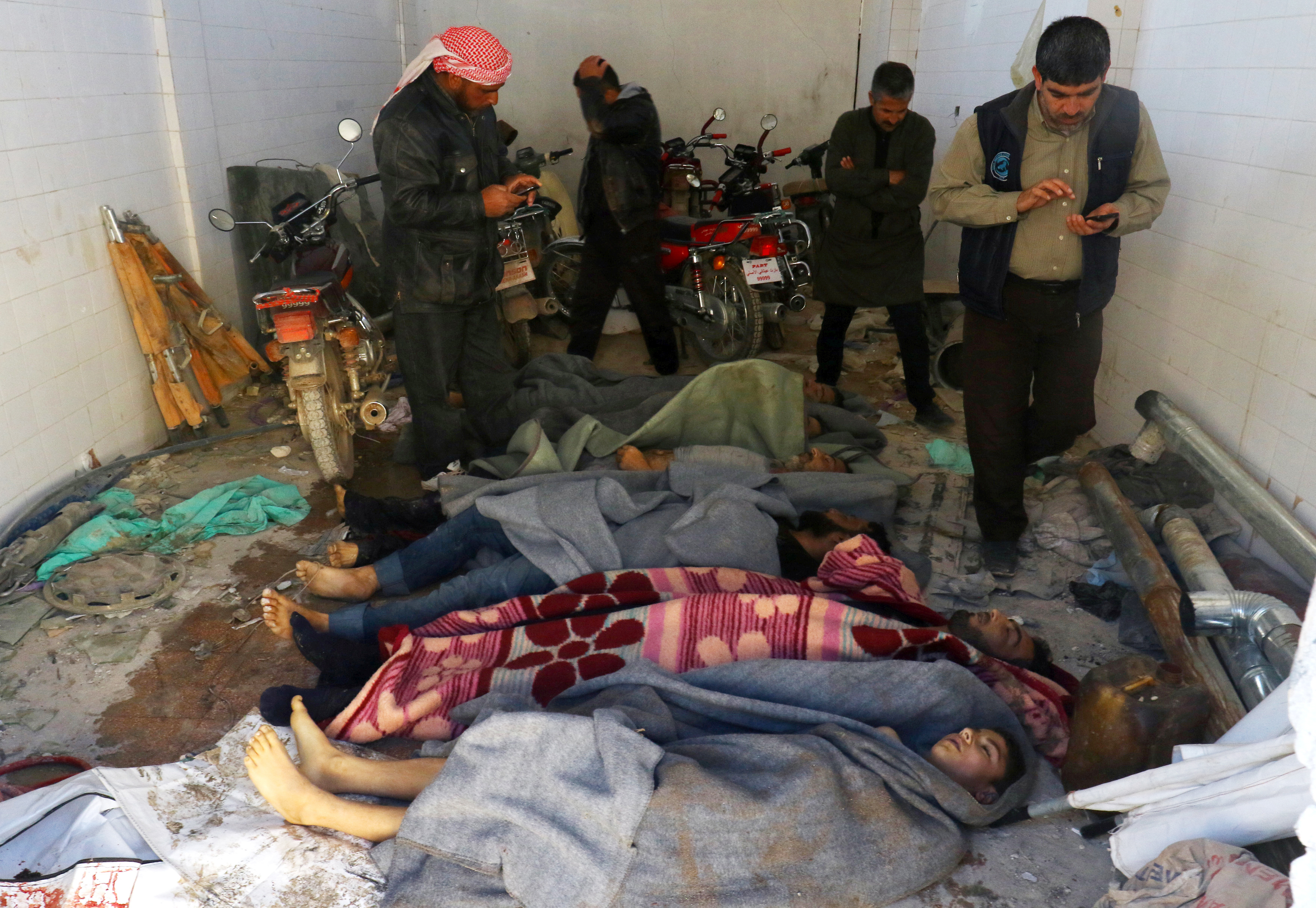 Bodies are wrapped in blankets after a suspected chemical attack in the town of Khan Shaykhun on Tuesday.     (Ammar Abdullah/Reuters)