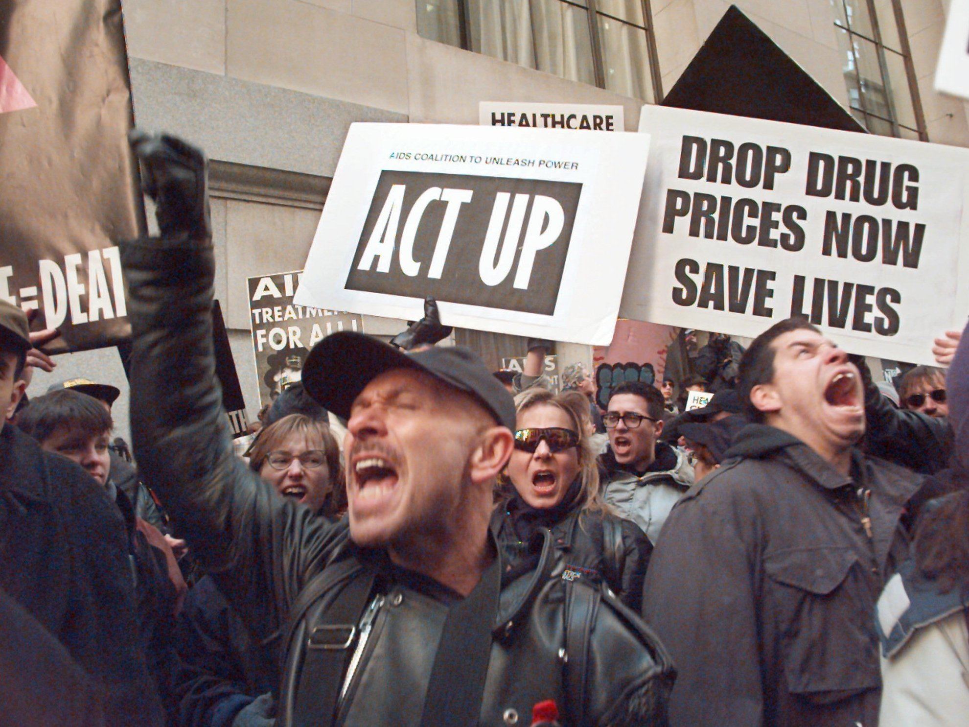 Protesters marked the 10th anniversary of the forming of ACT UP along Wall Street in New York City in 1997 by calling attention to the high price of AIDS drugs. (Mark Lennihan/AP)