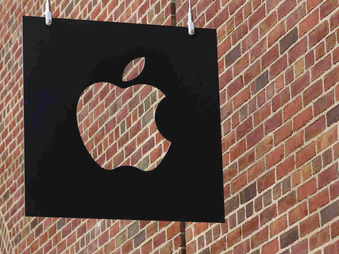 The Apple logo hangs in front of an Apple Store in Brooklyn, N.Y.