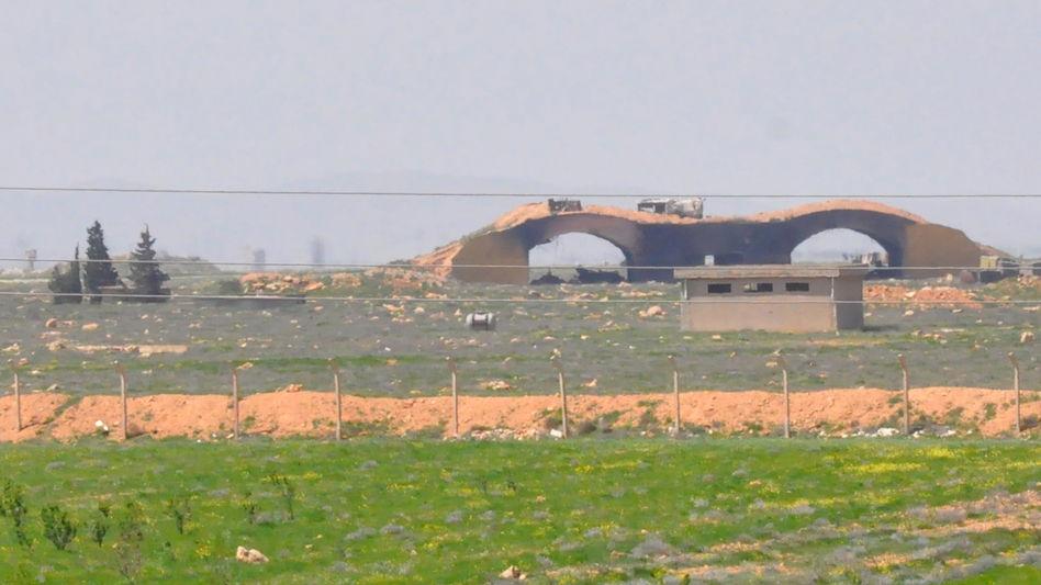 A picture taken Friday shows the damaged Shayrat airfield at the Syrian military base targeted overnight by U.S. Tomahawk cruise missiles, southeast of the central Syrian city of Homs. (AFP/Getty Images)
