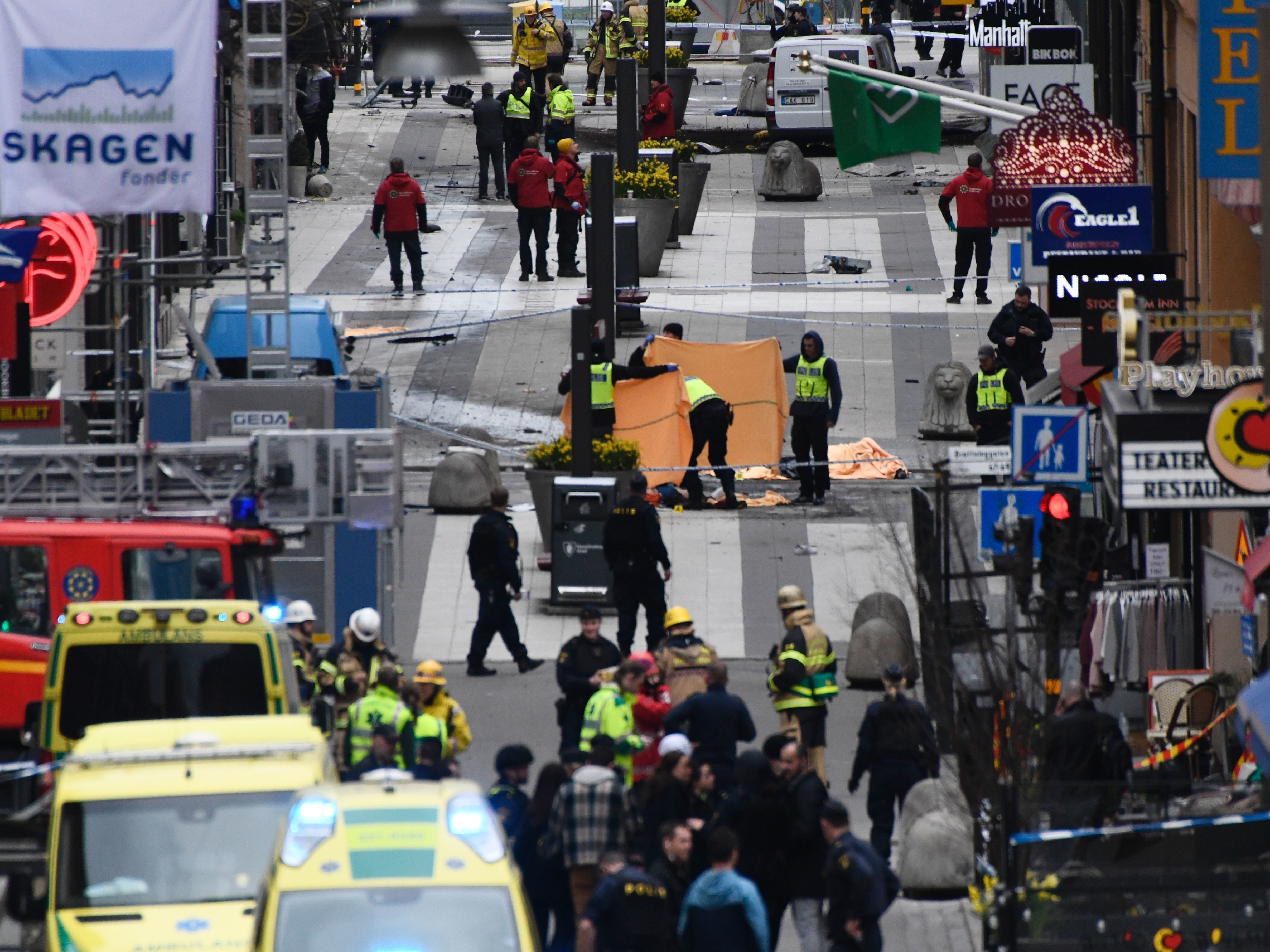 Emergency crews work at the scene where a truck crashed into the Ahlens department store in central Stockholm on Friday.     (Jonathan Nackstrand/AFP/Getty Images)