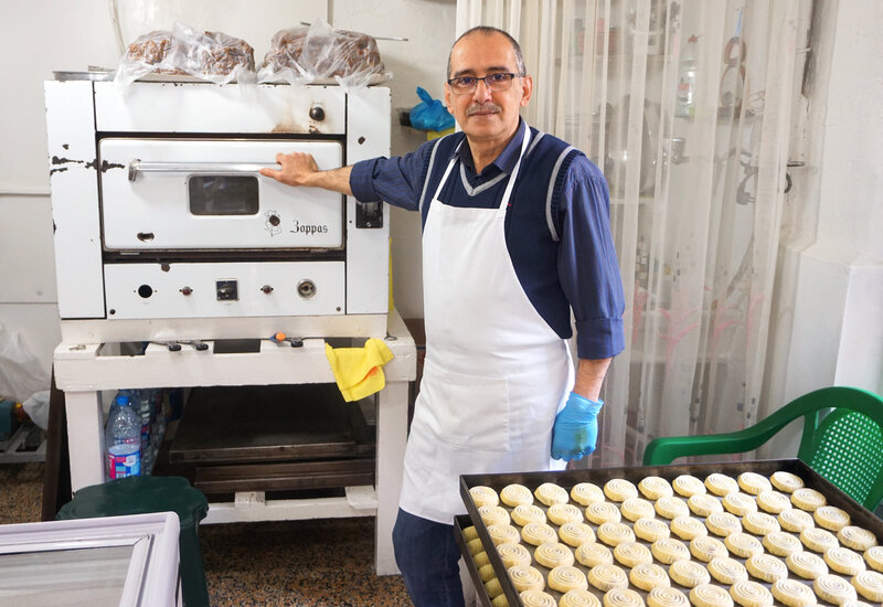 Image: Owner of Helwayat Al-Salam, Mitri Hanna Moussa. Mitri's family has been making maamoul for decades – even before they had an oven to bake them in. Amy E.Robertson for NPR