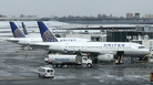 United Airlines airplanes sit on the tarmac March 15 at LaGuardia Airport in New York. The company is struggling with the public relations fallout from its violent removal of one of its passengers.