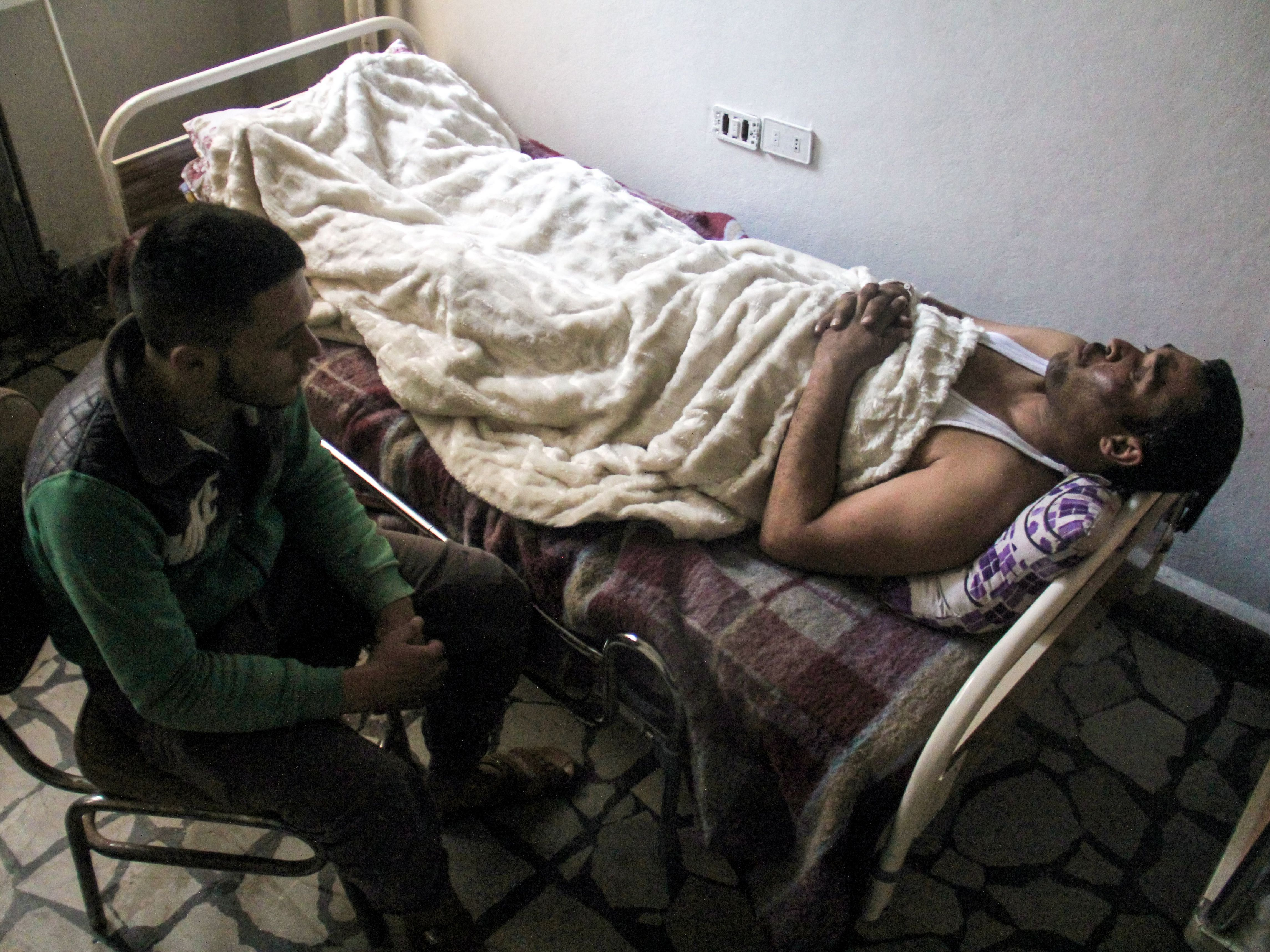 Hassan Youssef, a 40-year-old victim of the April 4 chemical attack in Khan Shaykun, receives medical care in a hospital in the nearby Syrian city of Idlib on Thursday.     (Omar Haj Kadour/AFP/Getty Images)