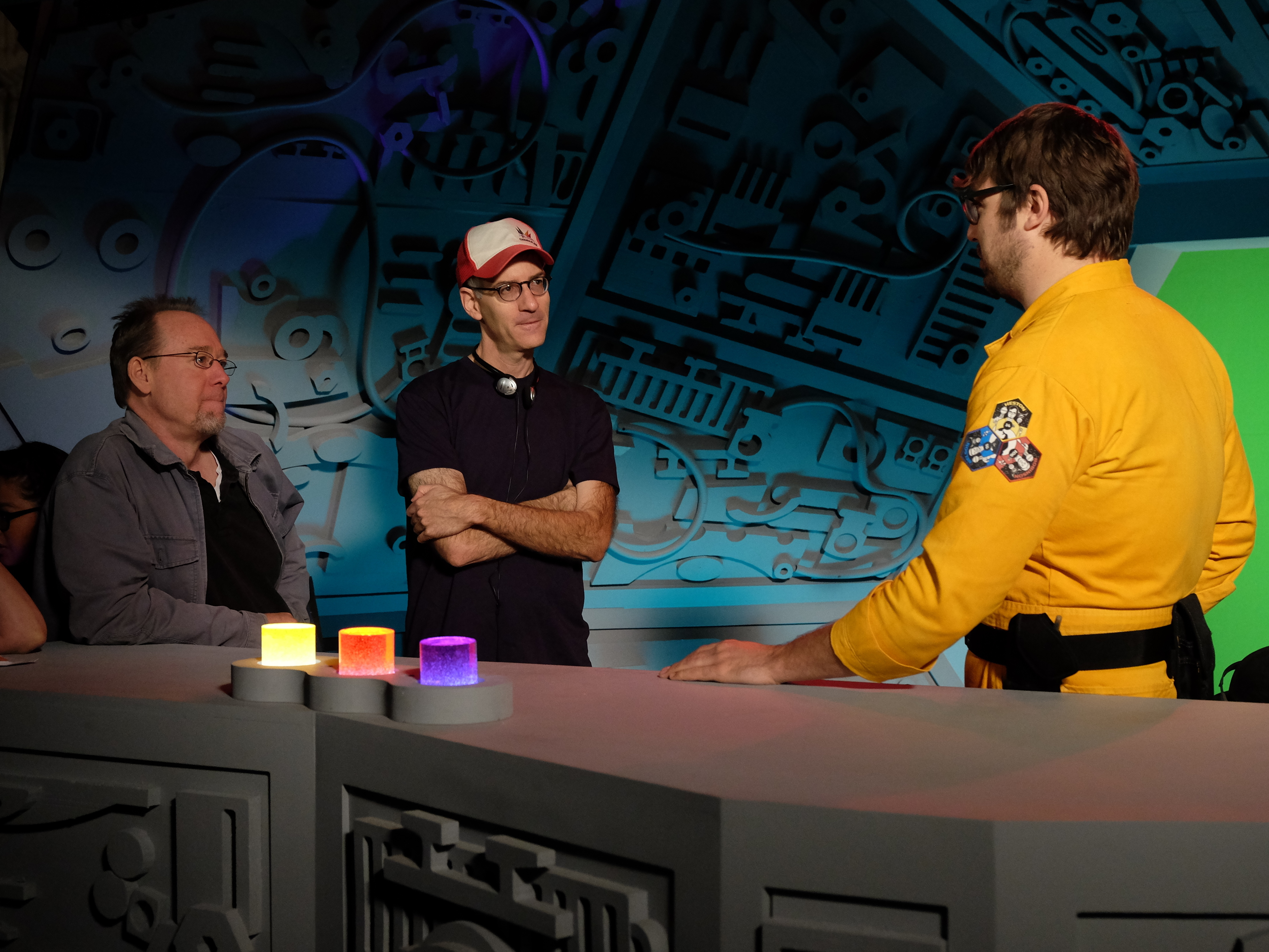 Hodgson and writer/producer Robert Cohen check in with Ray on the set of the new Mystery Science Theater 3000. (Darren Michaels/Courtesy of Shout Factory and Netflix)