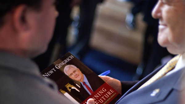 Former House Speaker and 2012 Republican Party presidential candidate Newt Gingrich autographs a copy of his book at a campaign event in Georgetown, S.C., in 2012. Gingrich published with conservative publishing house Regnery Publishing.