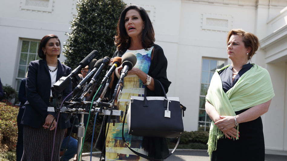 Marjorie Dannenfelser, president of the Susan B. Anthony List (right) and Seema Verma (left), administrator of the Centers for Medicare and Medicaid Services, look on as Concerned Women for America CEO Penny Nance speaks with reporters outside the White House on Thursday.