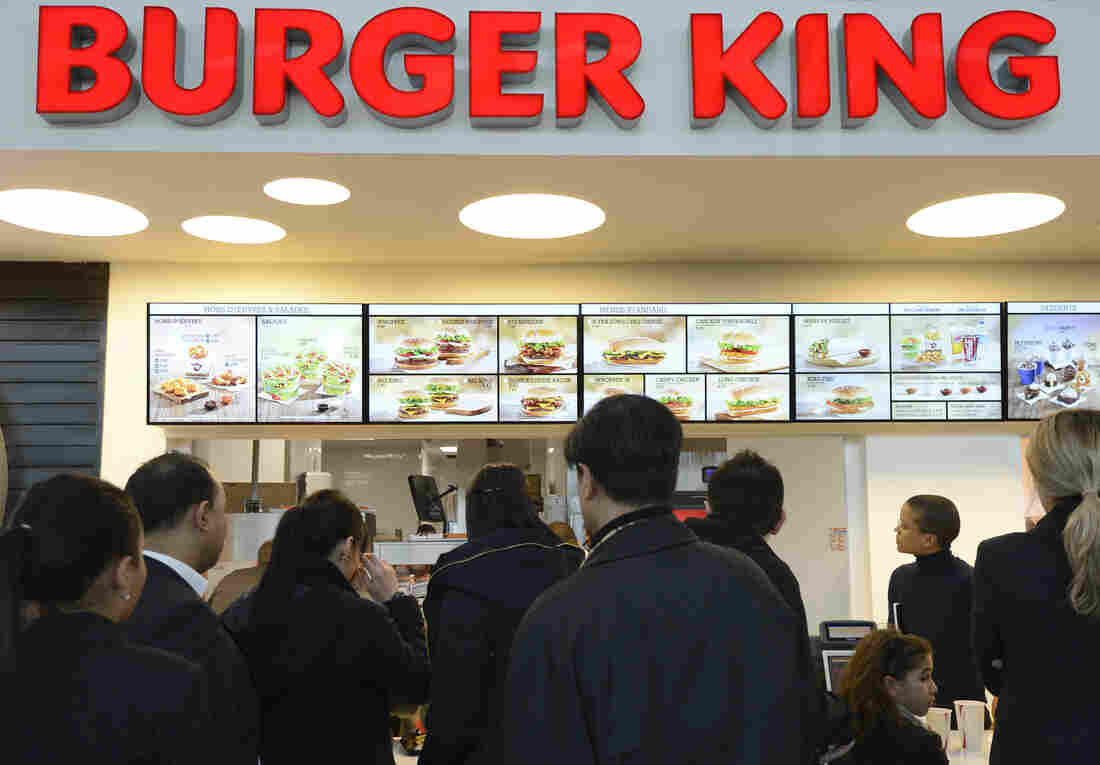 Customers await their orders at a Burger King in in Marignane, France, in 2012.