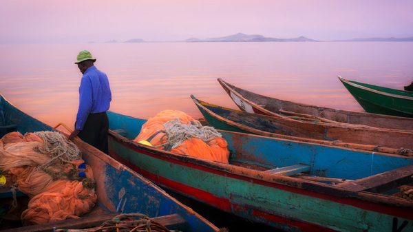 Fishing boats at sunset on Lake Victoria. They
