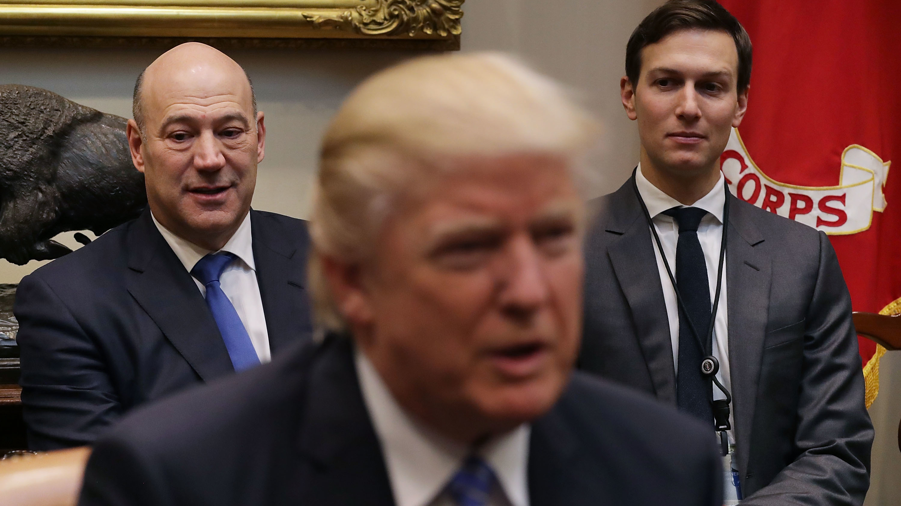 Trump's economic adviser Gary Cohn and adviser Jared Kushner listen to President Trump at a meeting with business leaders Jan. 23