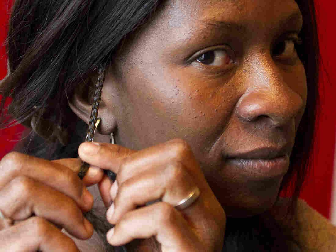 Jestina Clayton, former hair braider.