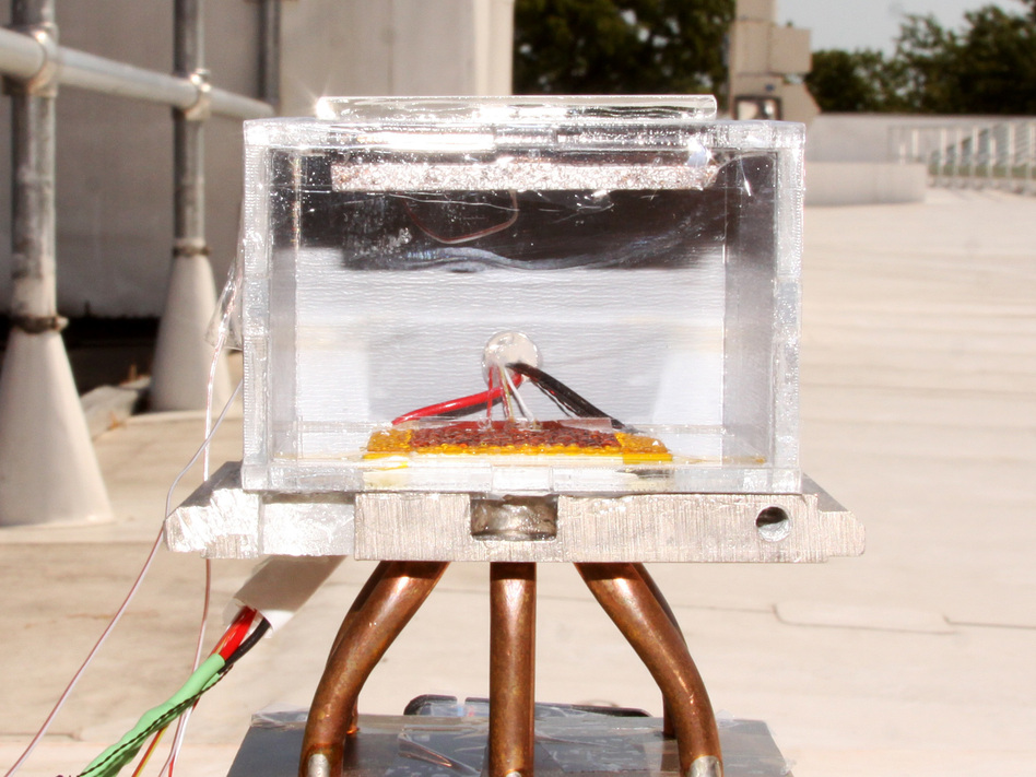 A prototype MOF-based water-collection device is set up for testing on the roof of a building on the MIT campus.