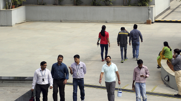 Wipro Ltd. employees walk inside the company
