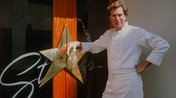 The irascible chef poses in front of his San Francisco restaurant in the documentary Jeremiah Tower: The Last Magnificent.