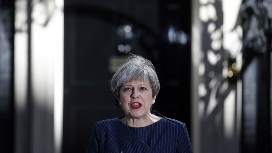 Britain's Prime Minister Theresa May speaks to the media outside her official residence of 10 Downing St. in London on Tuesday. May announced she will seek early elections to be held June 8. (Alastair Grant/AP)