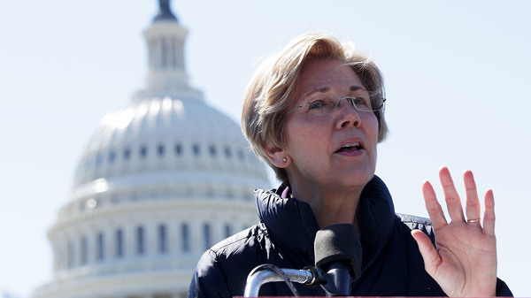 Sen. Elizabeth Warren, D-Mass., speaks during a rally in front of the Capitol on March 22. She writes about the middle class and activism in her new book, This Fight Is Our Fight.