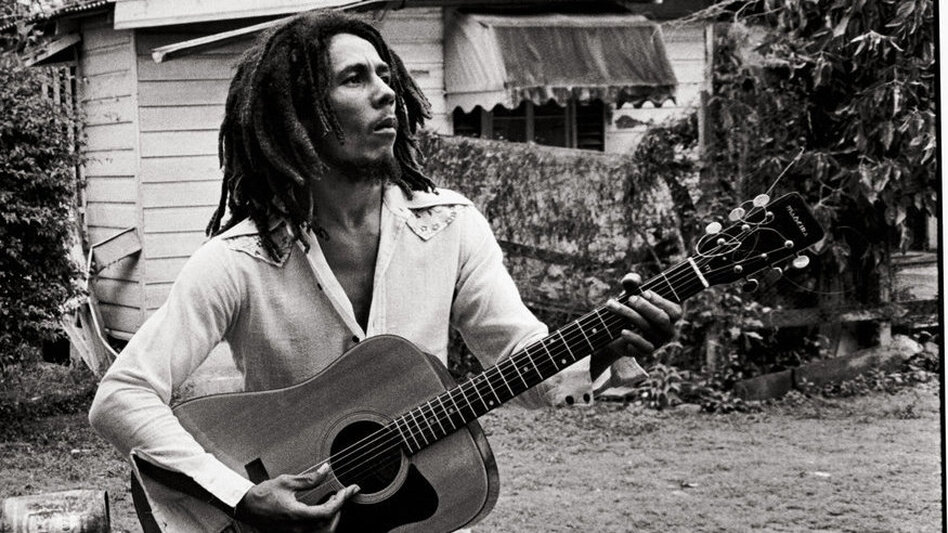 Bob Marley, with his guitar in the yard at Tuff Gong (his home and headquarters). Kingston, Jamaica, March 1976.