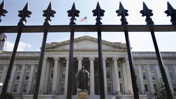 A statue of former Treasury Secretary Albert Gallatin stands guard outside the Treasury Building in Washington. Trump
