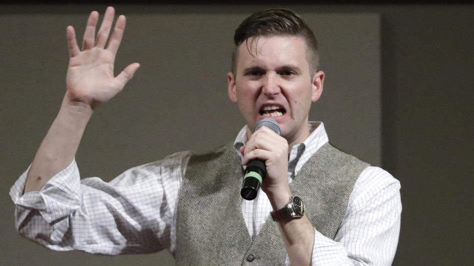 """Richard Spencer, a white nationalist who claims to have coined the term """"alt-right,"""" speaks at Texas A&M in College Station, Texas, in Dec. 6, 2016. (David J. Phillip/AP)"""