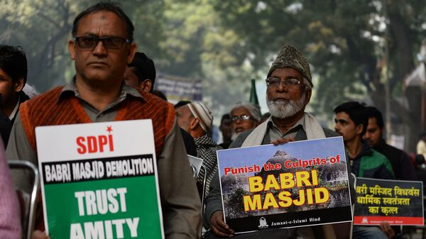 Indian activists carry placards displaying images of the Babri mosque during a December 2016 protest in New Delhi to mark the anniversary of the mosque