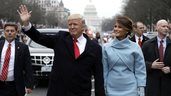 President Trump waves to supporters as he walks the parade route with first lady Melania Trump after being sworn in on January 20.