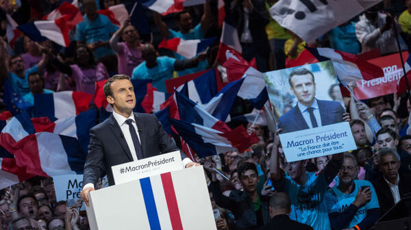 French Presidential Candidate Emmanuel Macron addresses voters during a political meeting on April 17 in Paris.