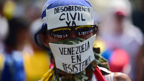 A demonstrator against Venezuelan President Nicolas Maduro