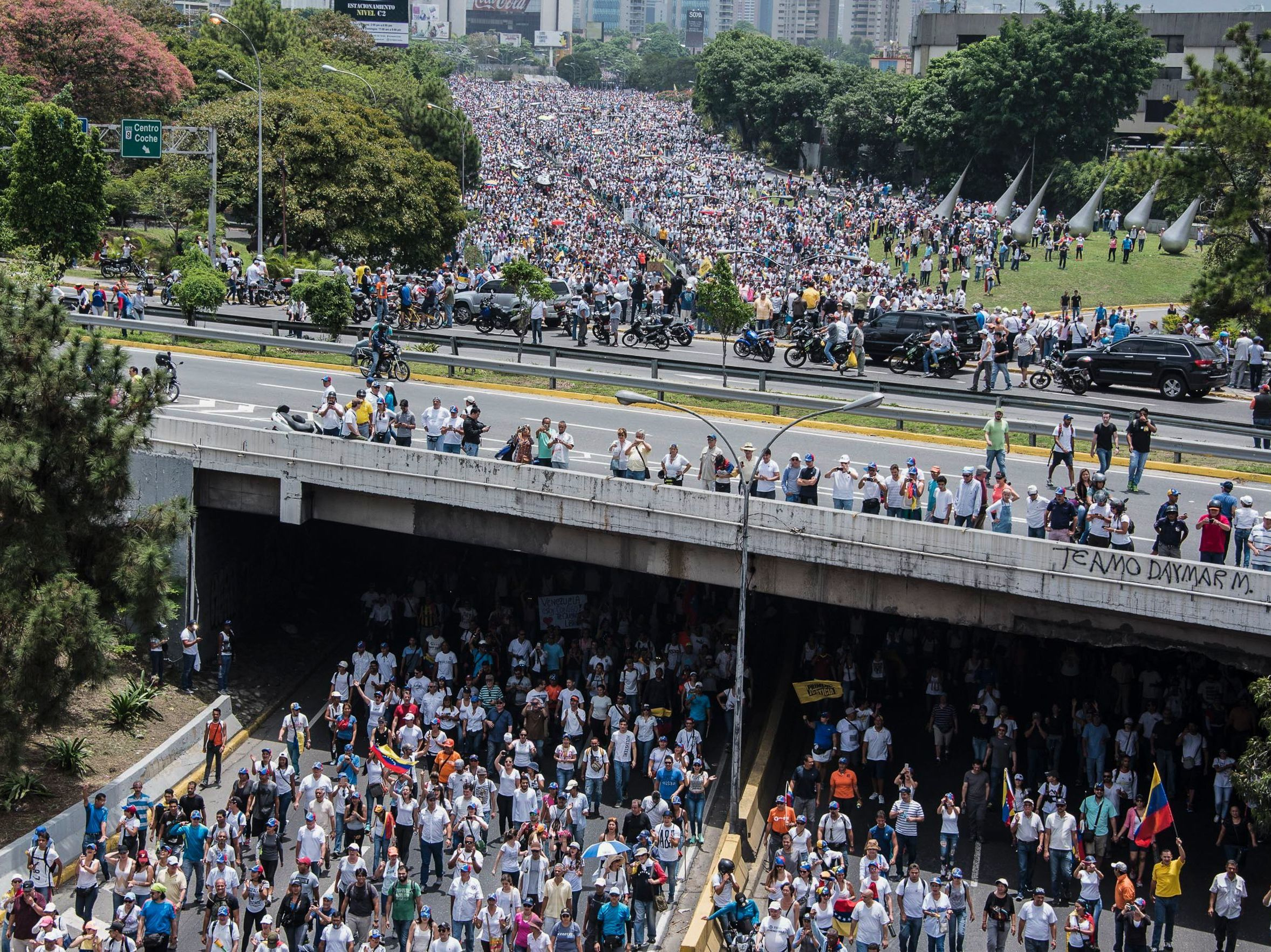 Demonstrators clog a Caracas highway on Wednesday, shouting their resistance to President Nicolas Maduro. The president's push to tighten his power has helped trigger deadly unrest in Venezuela. (Carlos Becerra/AFP/Getty Images     )