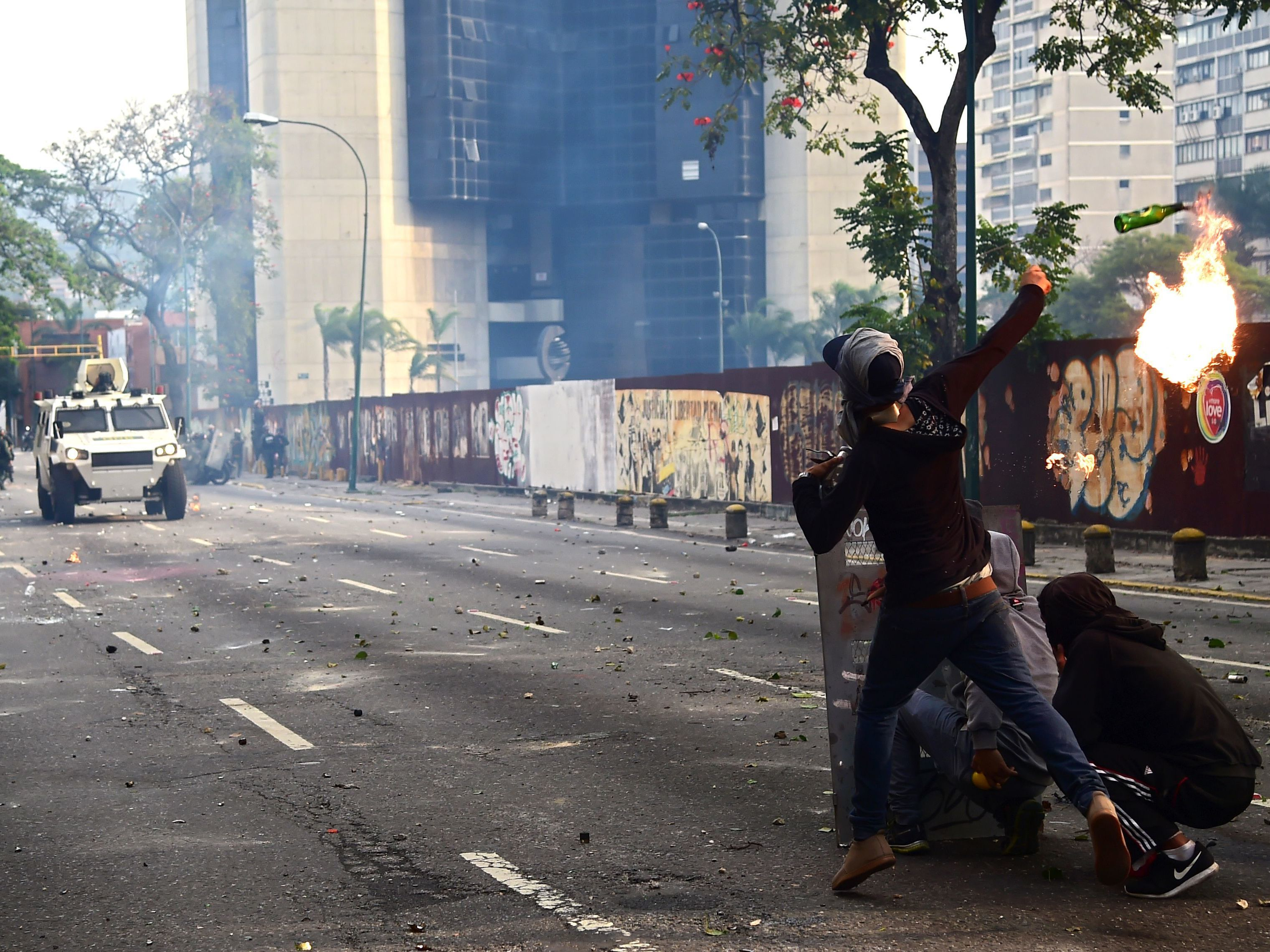 Demonstrators hurl flaming objects at riot police during a rally in Caracas against Venezuelan President Nicolas Maduro on Wednesday.     (Ronaldo Schemidt/AFP/Getty Images)