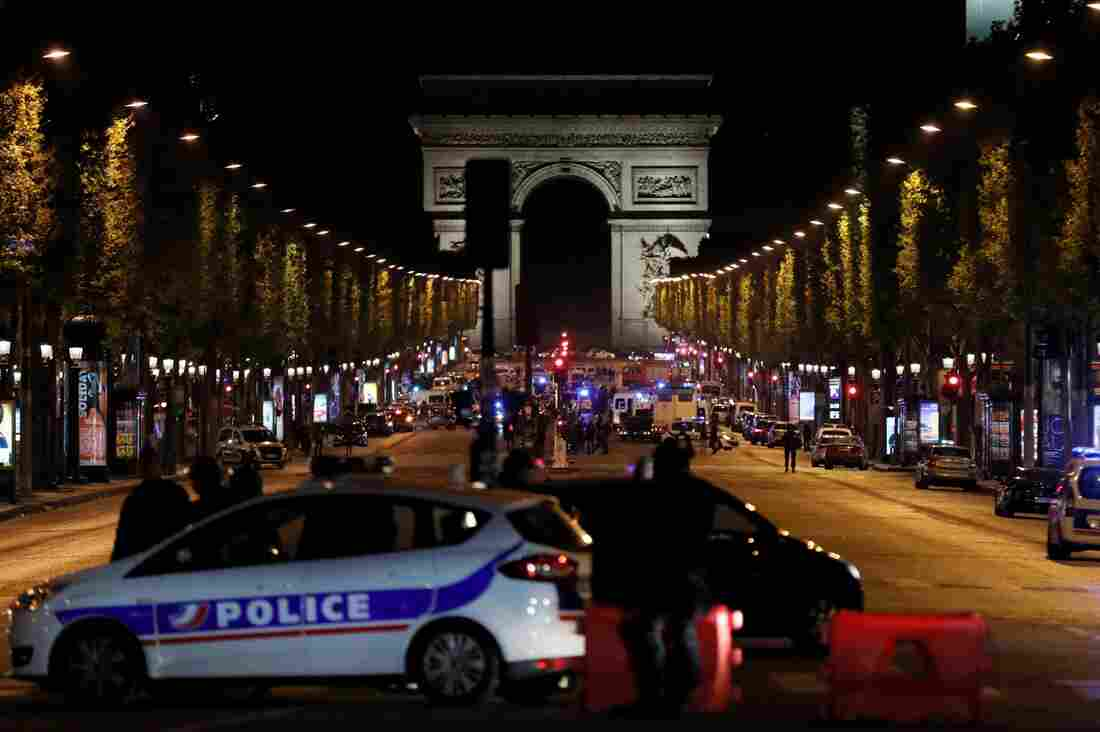 Paris police say officer and attacker shot, killed