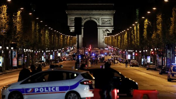 Police officers block access to the Champs Elysees in Paris after a shooting on Thursday. France