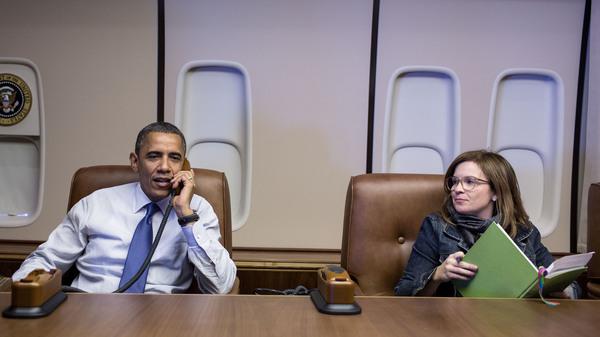 Alyssa Mastromonaco sits with President Barack Obama aboard Air Force One in 2012. Mastromonaco served as the president