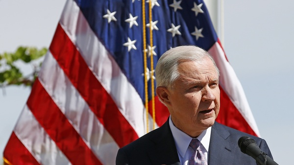 "Attorney General Jeff Sessions speaks at a news conference after touring the U.S.-Mexico border on April 11. The Justice Department is warning so-called ""sanctuary cities"" that they must prove they are complying with federal immigration laws or risk funding."