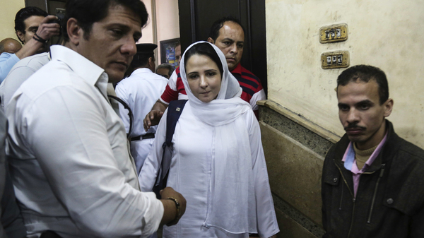 Aya Hijazi, center, a dual U.S.-Egyptian citizen, was acquitted by an Egyptian court on Sunday after nearly three years of detention over accusations related to the foundation she and her husband ran, dedicated to helping street children in Cairo.