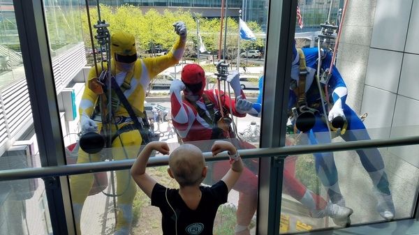 Window washers dressed as Power Rangers dangled outside Children