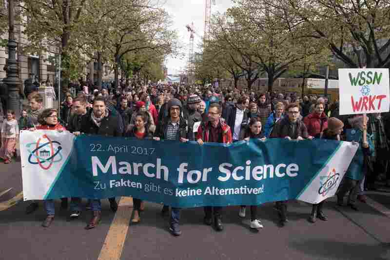 "Demonstrators participate in the March for Science in Berlin. The March for Science organizers have said their own events are nonpartisan, and the overarching mission is to ""[champion] robustly funded and publicly communicated science as a pillar of human freedom and prosperity."""
