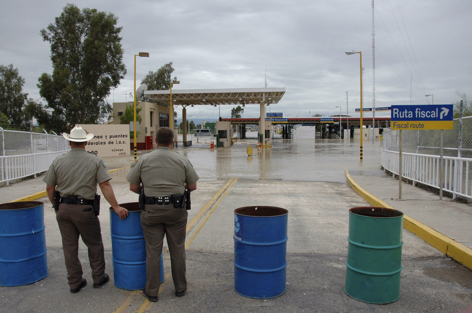 A view from the International bridge between Presidio, Texas, and Ojinaga, Mexico, shows the flooded checkpoint between the two cities on Sept. 17, 2008. A levee broke and water from the Rio Grande inundated parts of the city with 10 feet of water.