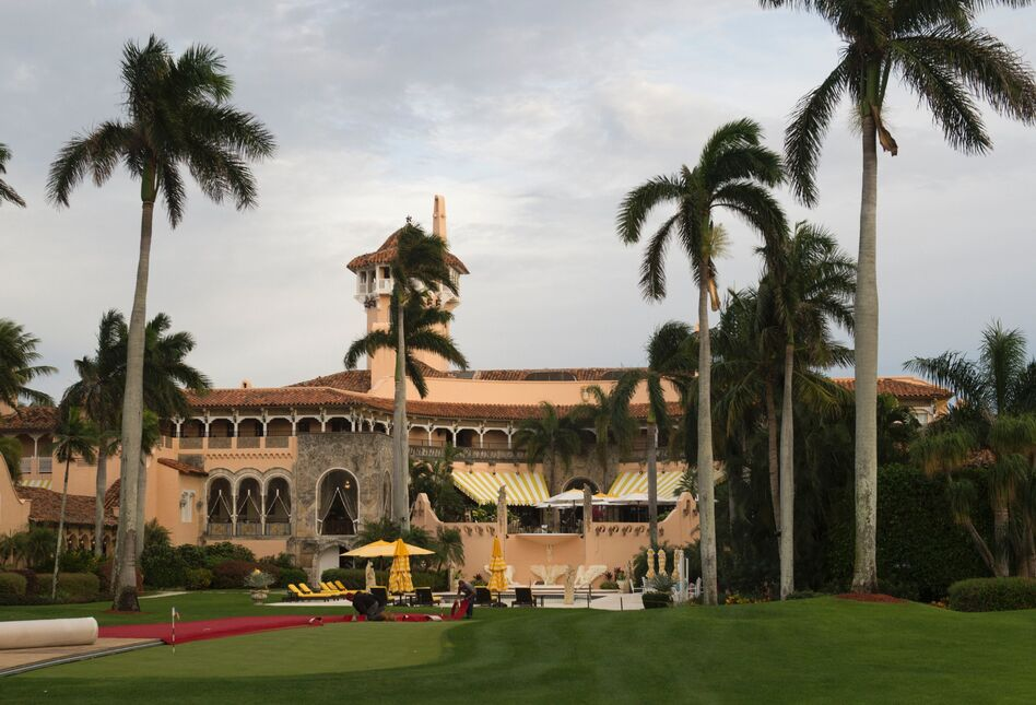 Workers lay out the red carpet at Mar-a-Lago Club in Palm Beach, Fla., on Dec. 30, 2016.