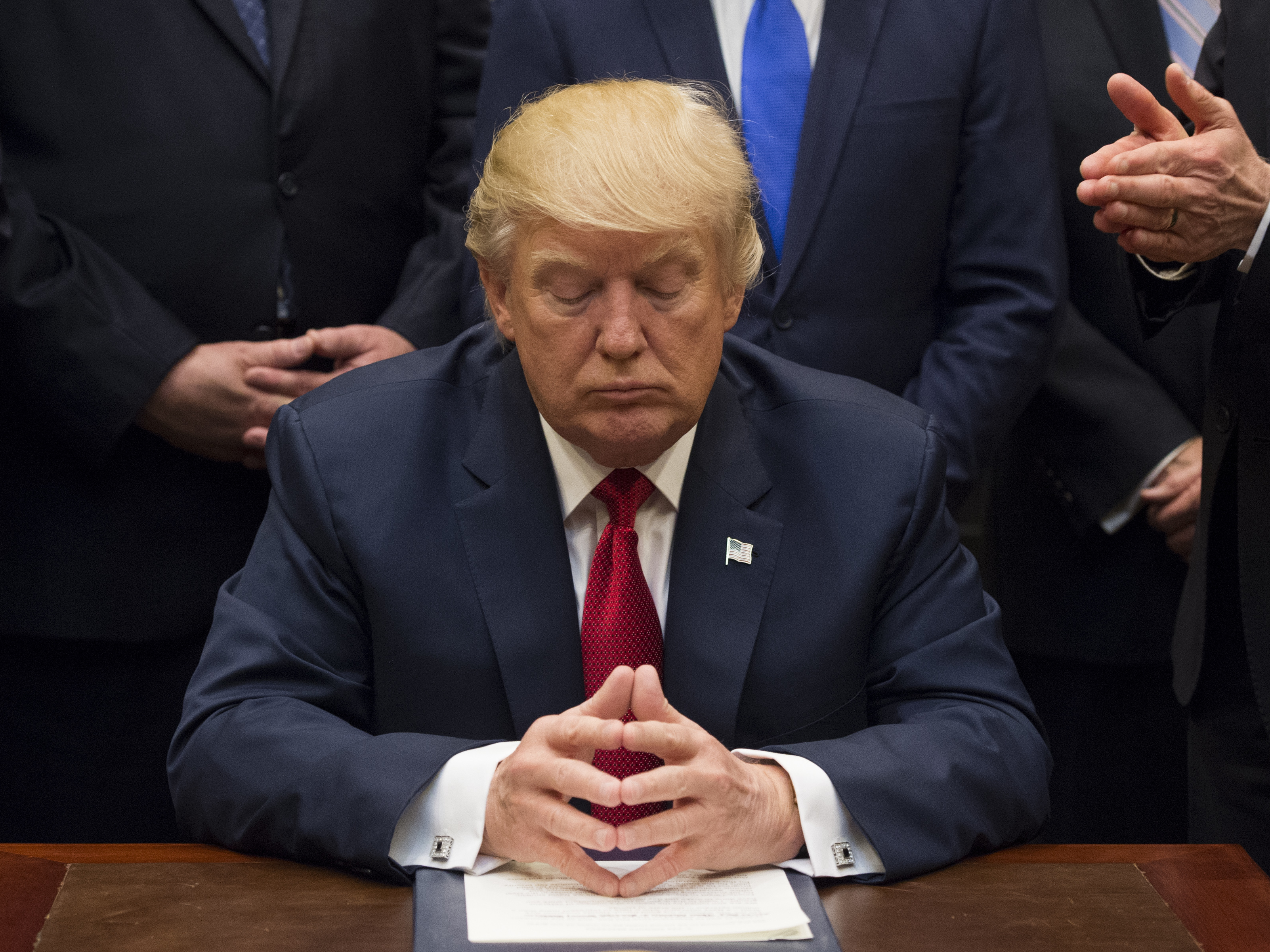 President Trump has left many scratching their heads on what kind of president he will be. His first 100 days as president offered conflicting messages. (Molly Riley/Pool/Bloomberg via Getty Images)