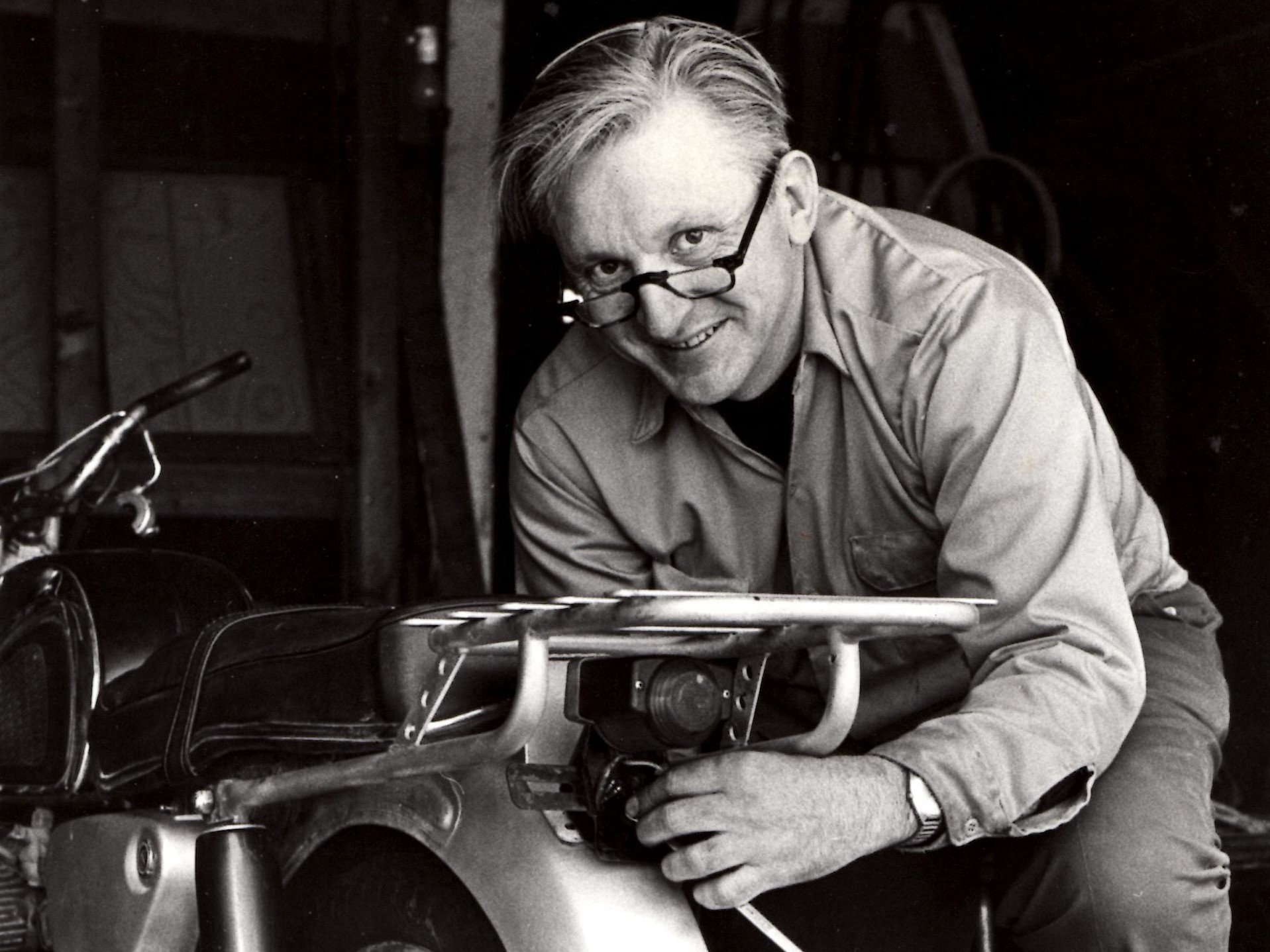 Author Robert Pirsig works on a motorcycle in 1975.     (William Morrow/HarperCollins)