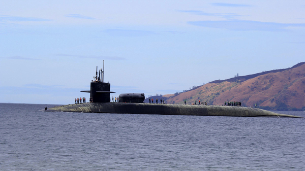 """The U.S. Navy says the USS Michigan, a guided-missile submarine, has docked in South Korea on a """"routine visit."""" It is shown here in 2014 west of Manila, Philippines."""